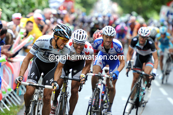 Not a chance hombre - Contador looks back to see Gilbert, Schleck, Evans and a few others on his wheel...