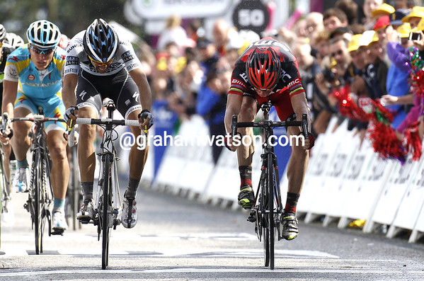 So close - Evans just pips Contador on the line, but the Spaniard will throw the victory salute..!