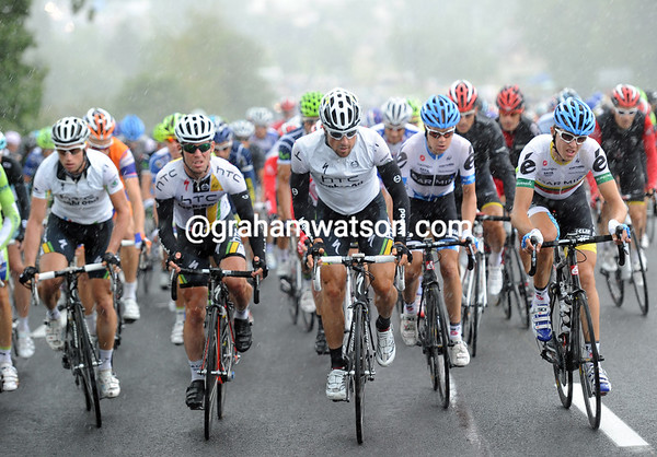 A massive rainstorm explodes on the peloton with Mark Cavendish near the front to stay out of trouble...