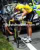 Thor Hushovd enjoys the last sunshine of the day as his mechanic changes the rear wheel...