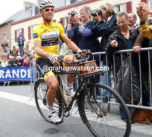 Thor Hushovd has swapped his shiny Cervelo for an ancient telegraph bike today...