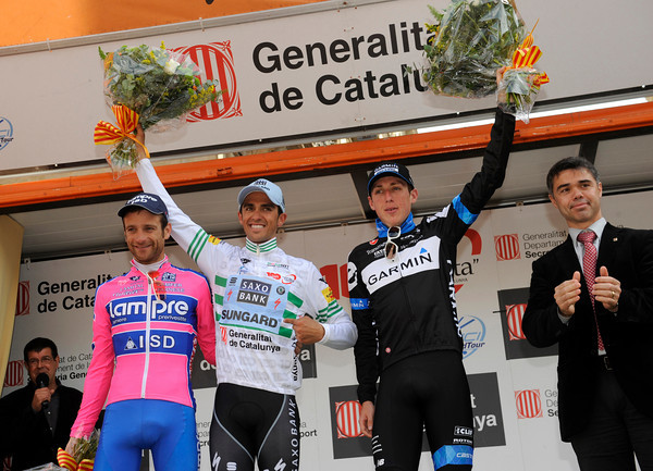 Alberto Contador celebrates another 2011 win, with Michele Scarponi and Dan Martin on the podium  with him...