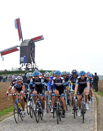 Hammond's Garmin teamates are making sure he gets the biggest advantage as the peloton crosses the day's first cobblestones...
