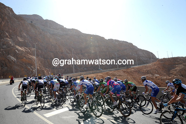 "The peloton approaches the first mountain of this year's race - it's called, ""Climb"" in the race manual...and it's very long and steep too!"