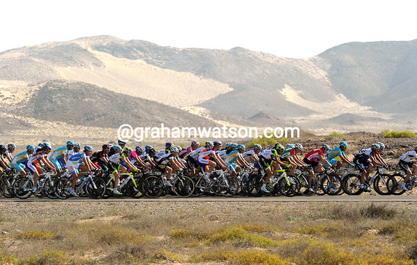 Great sand dunes create a unique horizon for the Tour of Oman peloton...