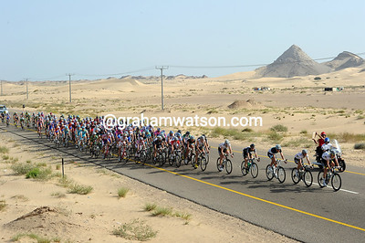 Sand is the only thing to be seen as the peloton turns to start the second half of the stage back to Sur...