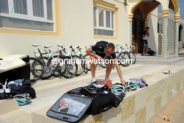 Joost Posthuma dresses and packs his bag on someone's terrrace in Sur...