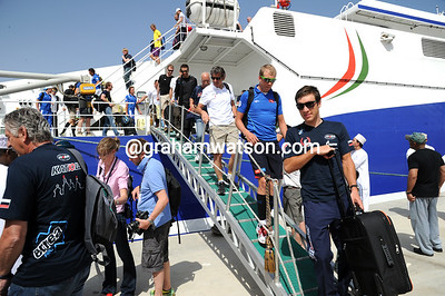The cyclists disembark from the high-speed boat less than one hour before the start...