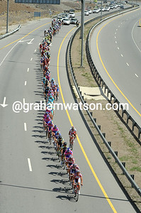Katusha leads a peloton strung out in their wake...