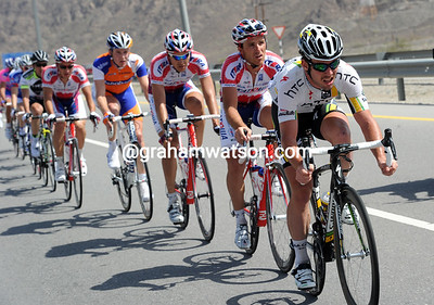 Mark Cavendiish is doing his share of work at the head of the chasing peloton...