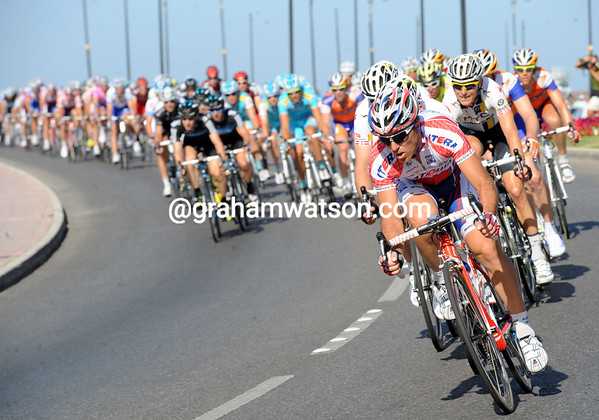 Katusha now lead the peloton with one lap to go...