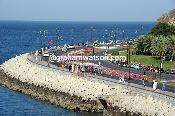 A colourful sight as the peloton starts to chase harder along Muscat's Corniche...