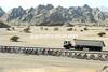 A peloton, a truck, a glorious Omani landscape is created..!