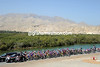 The peloton rolls away from the start at Qurayyat amongst spendid Omani scenery...