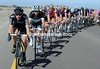 Team Sky start the chasing, with Kurt Asle Arvesen at the head of a long line of shadows...