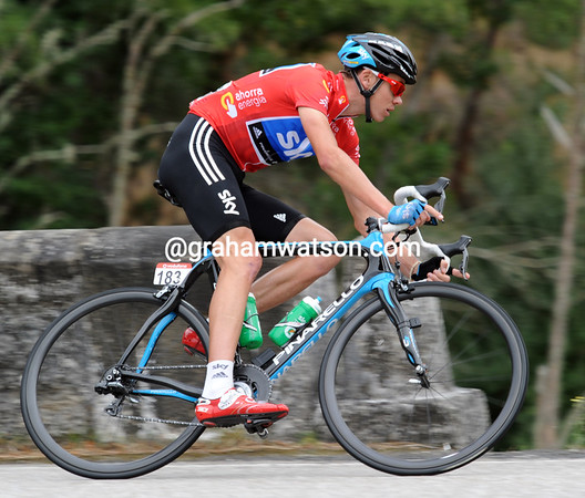 Chris Froome speeds through a corner near the head of the peloton - no need to stress just yet..!