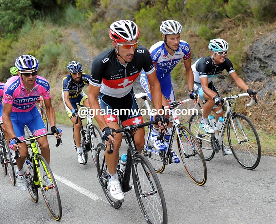 His work done, Cancellara is dropping to the back of the race with Tom Boonen - and Michele Scarponi..!