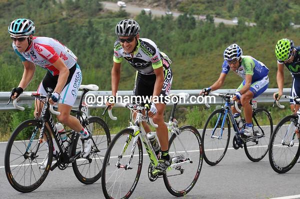 Carlos Sastre starts another move on the next climb, the Pico de Peña...