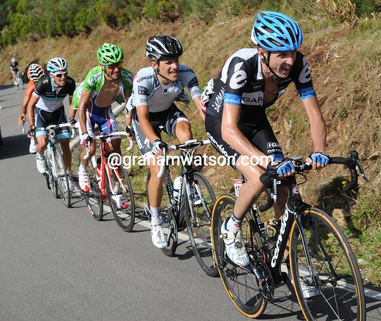 Dan Martin is a bit further back with Sorensen and Rodriguez on his wheel and suffering...