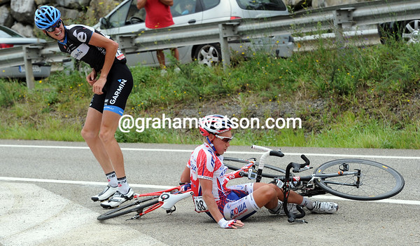 Johan Van Summeren looks at Yuri Trofimov in disgust after a crash in the opening kilometres...