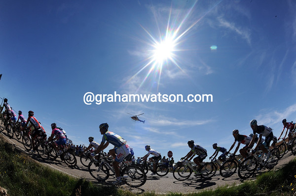 The peloton is being heated by a strong sun today - and it will get even hotter..!
