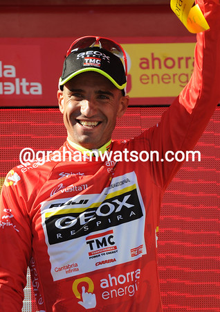 Juan Jose Cobo is also smiling, but his lead has shrunk to just 13-seconds...