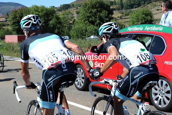 The climb of the Portillo de Lunada has become - Stuart O'Grady tries to nurse his tired teamate, Oliver Zaugg...
