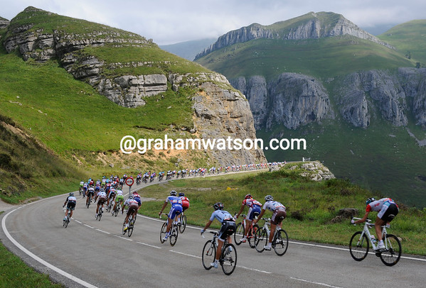 The peloton descends the Alisas, dwarfed by their surroundings in the Cantabrian mountains...