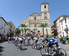 The peloton leaves the picturesque town of La Nucia...