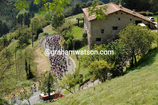 The peloton climbs the 1st category Alto del Elosua about five minutes behind the escape...