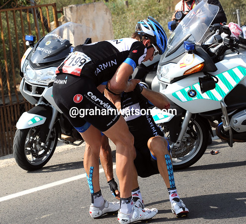 Sepp Van Marcke has ridden back to help his teamate - Le Mevel will make it back to the peloton...