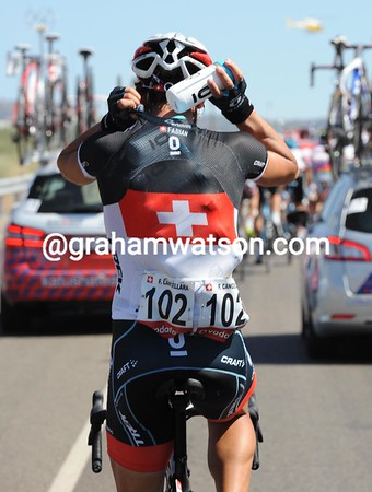 Swiss hospitality - Fabian Cancellara collects water bottle for his thirsty teamates...