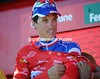 Sylvain Chavanel pulls on another red jersey as race-leader...