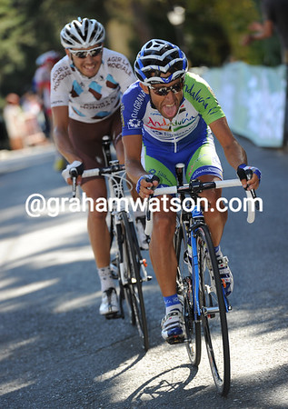 Palomares and Montaguti are just ahead of the peloton as the climb to El Escorial begins...