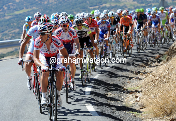 Katusha quickly gobbles Sastre up, and the gap to the four escapers is coming down too...
