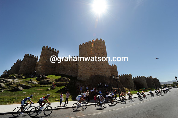 The peloton speeds through the walled city of Avila seven minutes later...