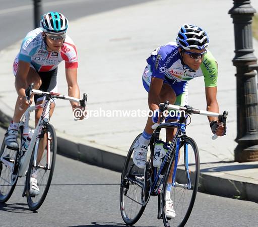 Just like yesterday, two riders have broken away - Jose Vincent Toribio and Sebastian Lang...