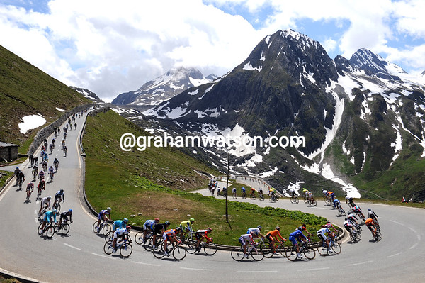 Down we go - the peloton is stretched out on the long, fast, and very beautiful descent...