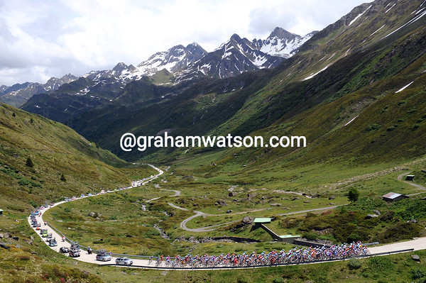 The peloton obliges photographers by kindly staying as one up the long climb...