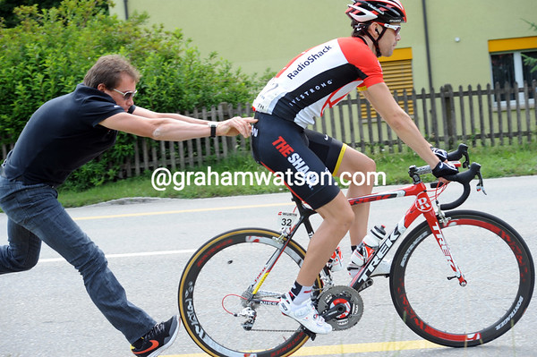 Precise stuff - Ekimov pushes Deignan back into the race with only his fingertips...