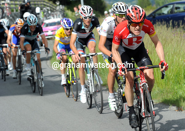 Levi Leipheimer shows his pace as well, reducing the gap but not actually attacking for himself...