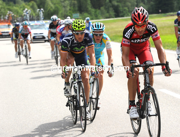 Hincapie starts to chase De Gendt down, but he gets no help from anyone else and sits up...