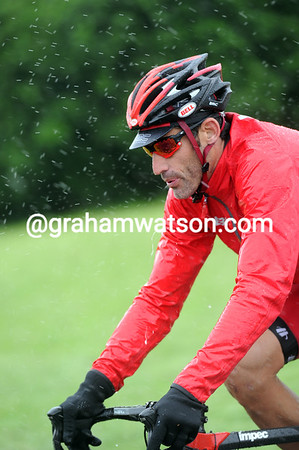 Time to reflect - George Hincapie endures the deluge...