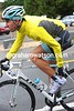 Fabian Cancellara is taking his overshoes off - the Swiss cyclist must know the weather is getting better, he lives here..!