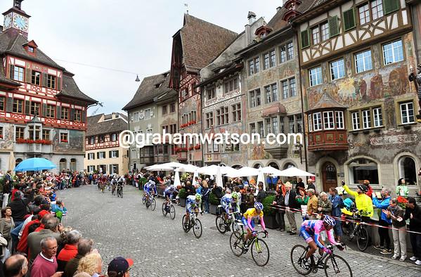 The peloton races through the spectacular town of Stein-am-Rhein....