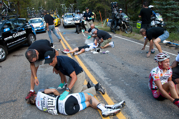 Unfortunately there has been a nasty crash at a cattle guard. Seventeed or so riders went down, three riders will be ambulanced away as the peloton eases up to regroup.