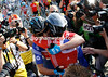 Cavendish hugs teamate Geraint Thomas after the thrilling finale...