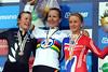 Jidith Arndt shares her winner's podium with Linda Villumsen and Emma Pooley