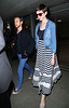Non-Exclusive<br /> 2012 July 31 - Anne Hathaway and Adam Shulman arrive at JFK Airport in NYC. Photo Credit Jackson Lee