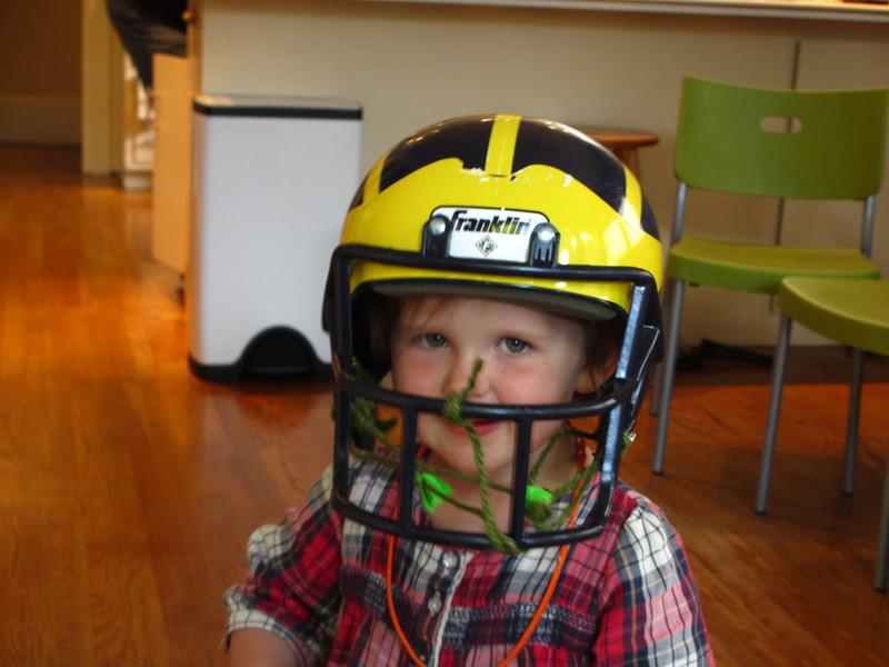 Sigrid's sister Astrid in Michigan football helmet